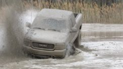 GMC Truck Battles In The Mud Pit